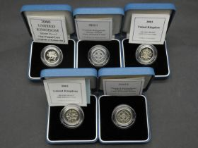 Five Royal Mint one pound silver proof coins. All in pale blue presentation cases with COA's.
