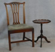 A Georgian mahogany Gothic carved dining chair and a small Georgian style mahogany occasional table.