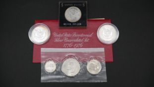A collection of silver coins. Including a 1976 US uncirculated Silver proof Bicentennial 3 Coin Set,