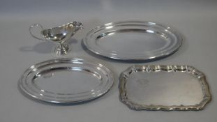 Three silver plated serving trays and a WMF gravy boat with scrolling handle and maker's stamp to