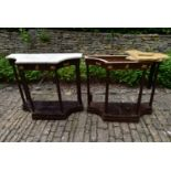 A pair of French Empire mahogany console tables with marble tops and classical motif ormolu mounts