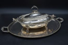 A large twin handles silver plated tray and a serving tureen with hotplate and cover. L.60cm (tray)