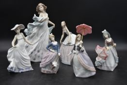 A collection of six Lladro female figures. H.33cm (largest)