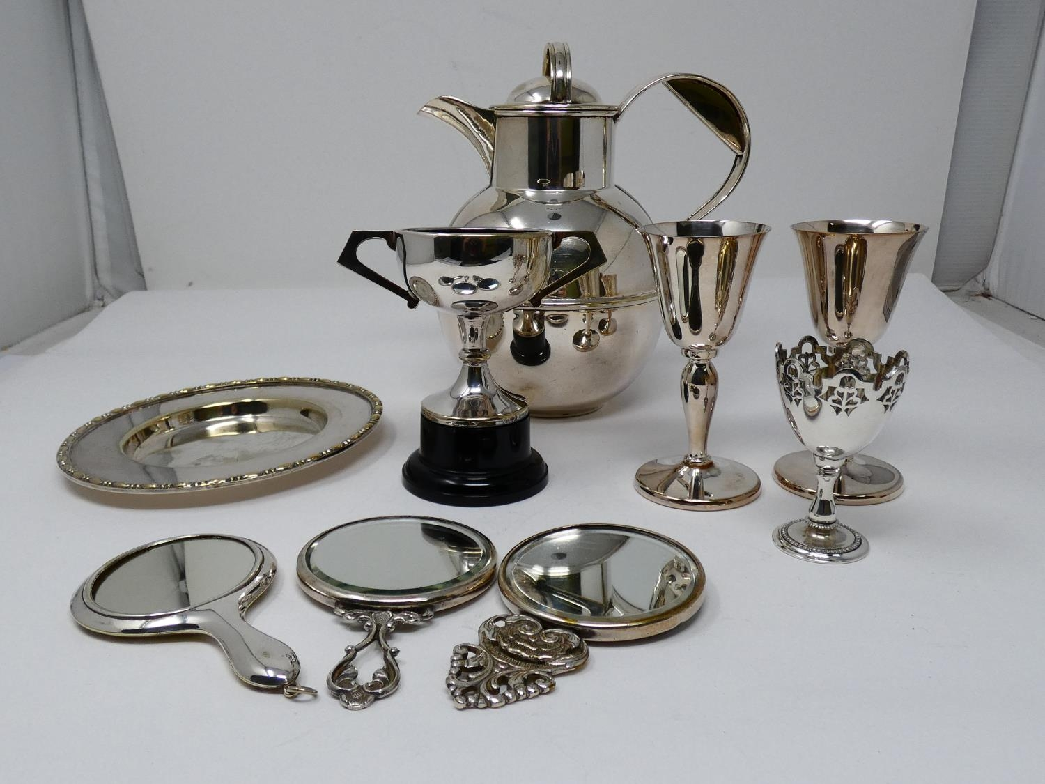 A collection of silver plated items; a hot water jug, trophy cups, card tray and hand mirrors (one - Image 2 of 23