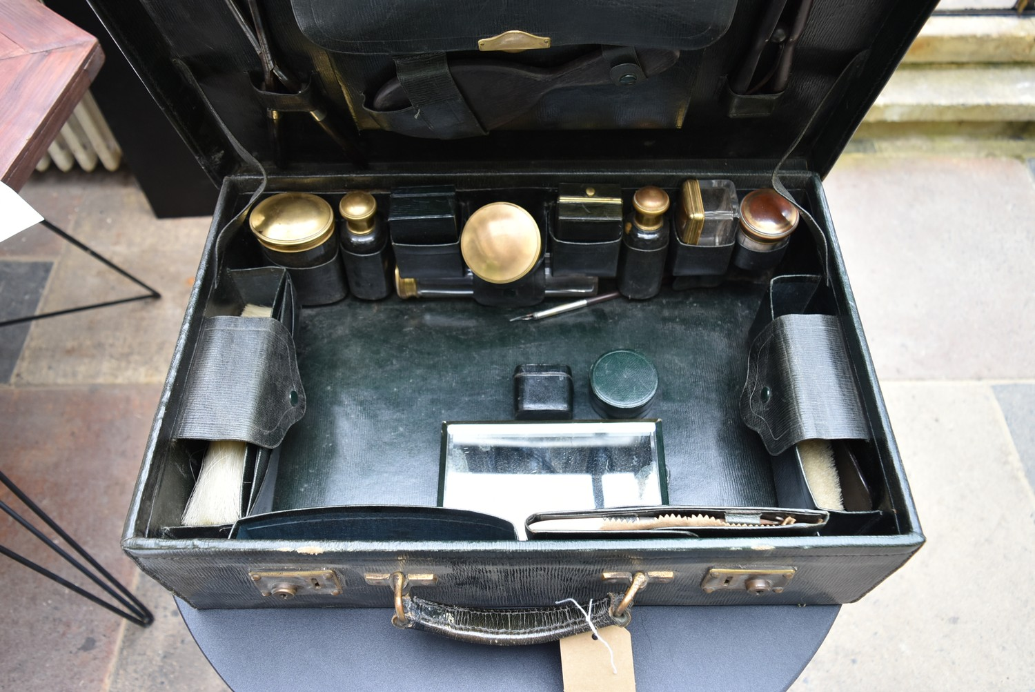 An early 20th century leather travelling gentleman's dressing case, well fitted with a wide - Image 5 of 10