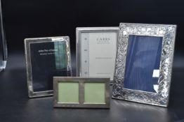A collection of four silver easel picture frames, various English hallmarks. H.28cm W.20cm (largest)