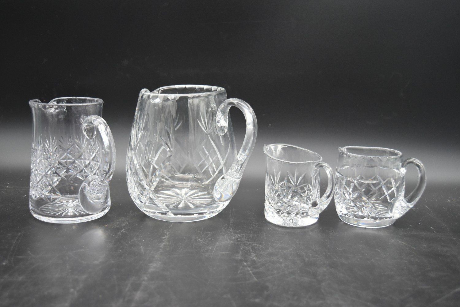 An extensive suite of cut crystal to include port and sherry glasses, champagne cups, vases, water - Image 14 of 15