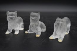 Three Lalique frosted glass figures of Yorkshire Terrier dogs, one standing, one sitting and one