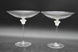 A boxed pair of Versace glass candy bowls with Medusa mask stems by Rosenthal. H.25cm