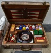 A vintage games compendium to include chess, draughts, backgammon, dominos and roulette in fitted