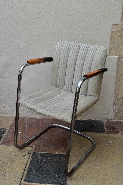A vintage armchair on chrome cantilever base. H.83 W.53cm