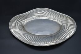 A 19th century Italian silver serving tray with shaped and wavy gadrooned rim, stamped 800, Arona