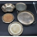 A silver plated twin handled galleried tray, a silver plated bread board and three other silver