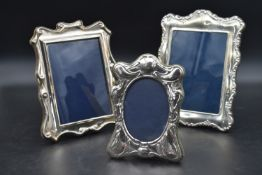 A collection of three silver easel picture frames, various English hallmarks. H.26cm W.20cm (