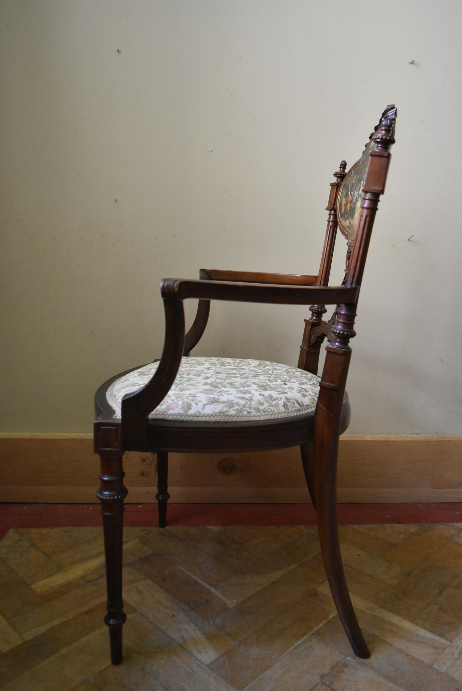 A late 19th century carved walnut salon armchair with hand painted back panel on fluted tapering - Image 5 of 5