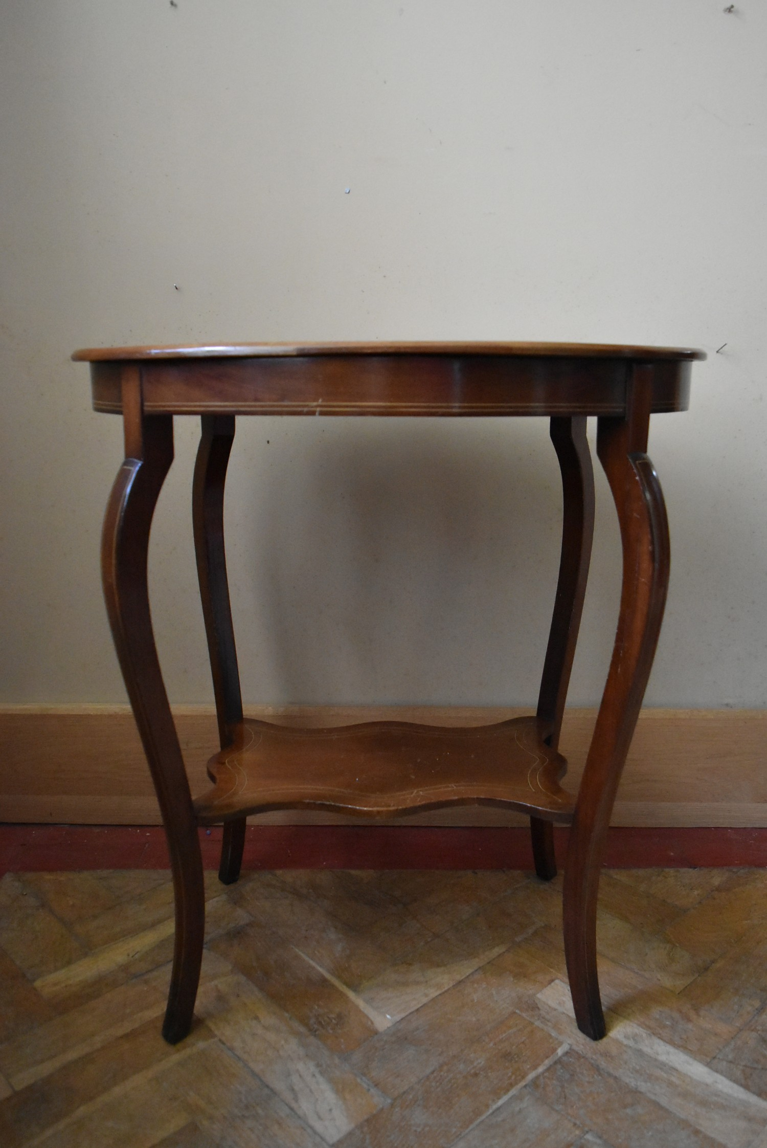 A late Victorian rosewood centre table with central floral spray inlay on shaped cabriole supports