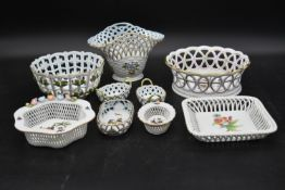 A collection of nine items of basket weave design bowls, dishes and vases by Herend with hand gilded