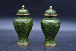 A pair of Chinese cloisonné lidded vases with all over floral enamel decoration. H.23cm