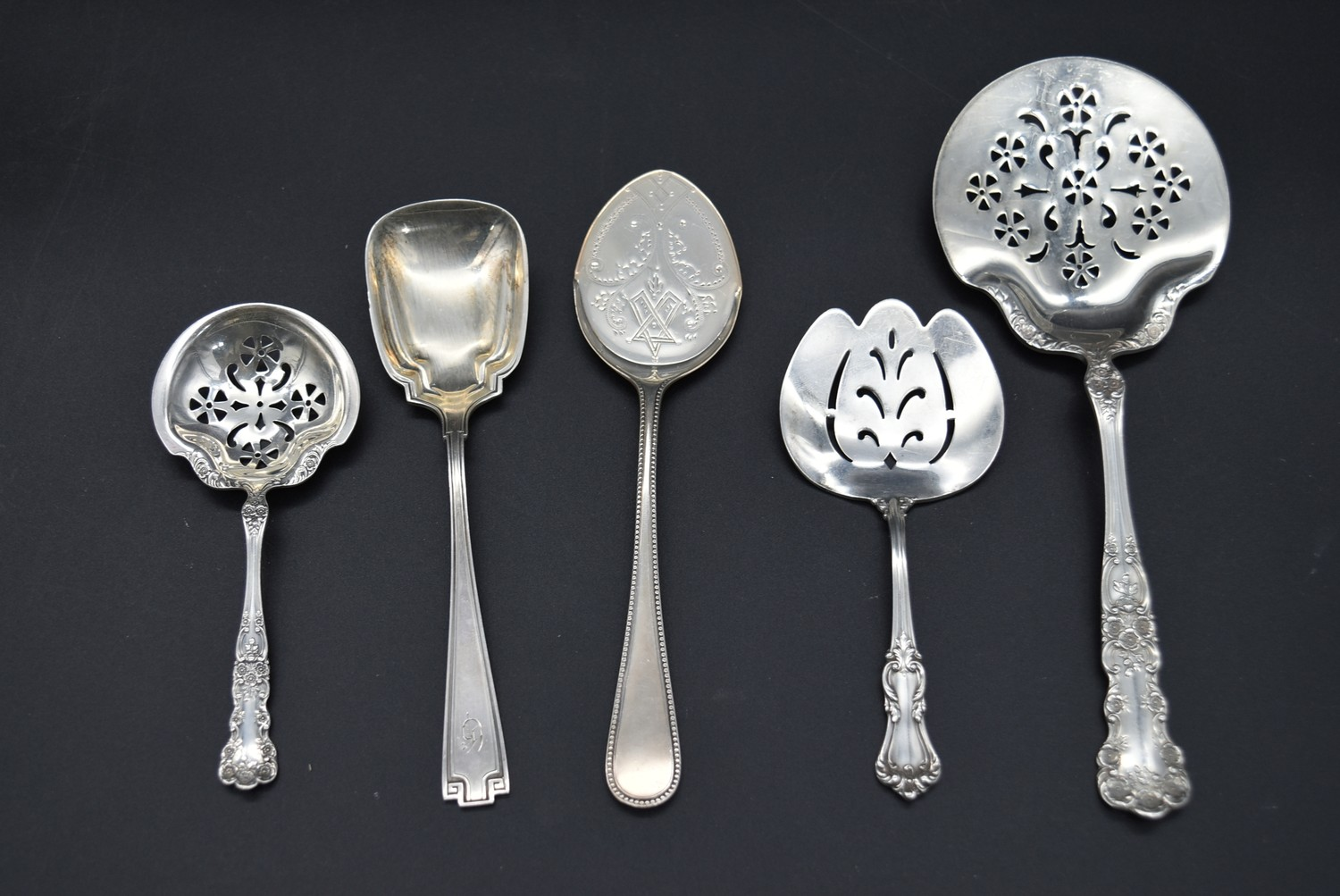 A collection of five 19th century and later English silver spoons along with a silver toast rack, - Image 2 of 6