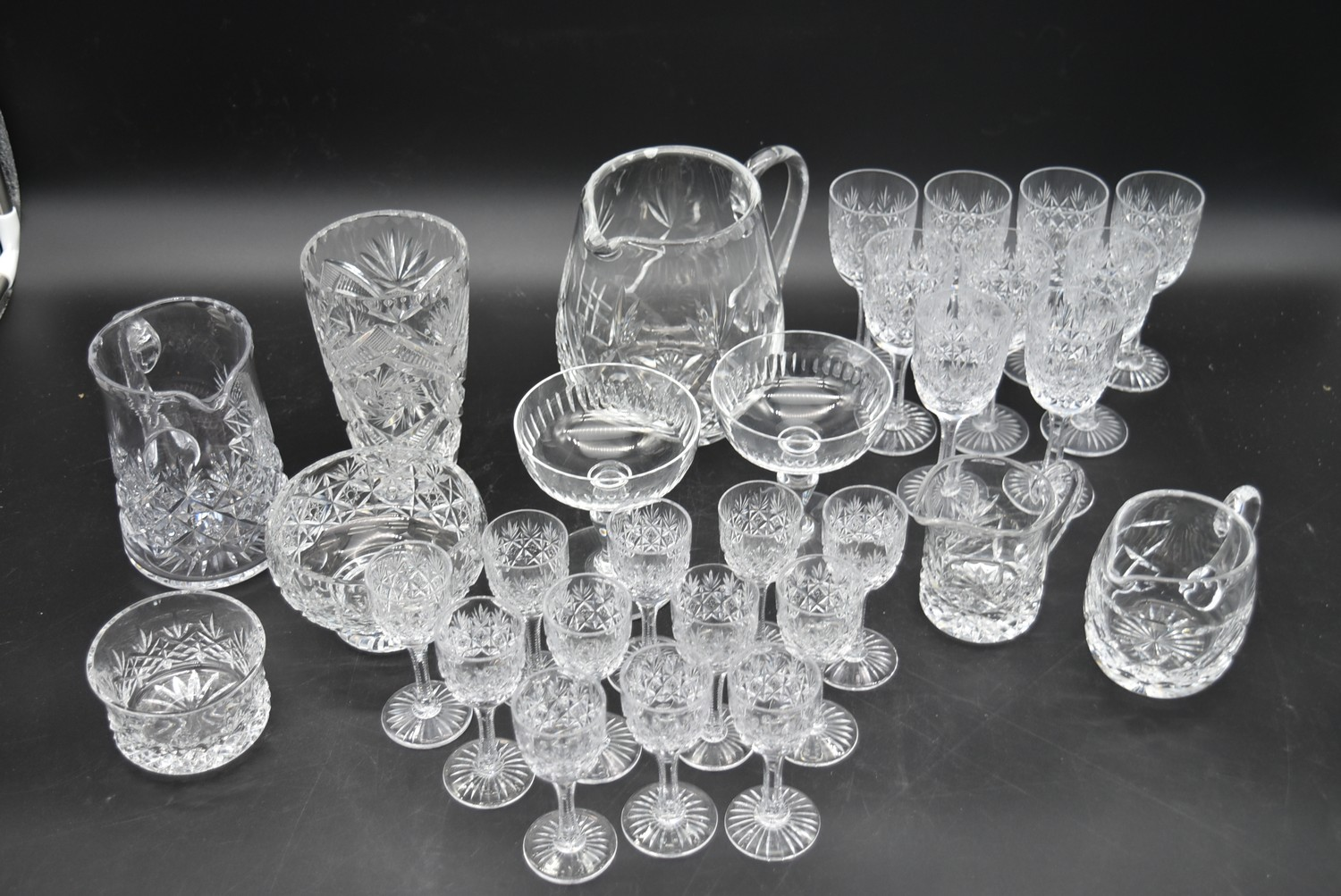 An extensive suite of cut crystal to include port and sherry glasses, champagne cups, vases, water - Image 2 of 15