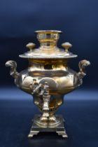 A brass twin handled hot water urn. H.40cm W.32cm
