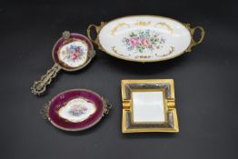 Limoges; two matching hand gilded and decorated ormolu mounted dressing table trays, a similar