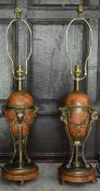 A pair of French Empire style faux marble table lamps with gilt metal ram's head detail. H.77cm W.
