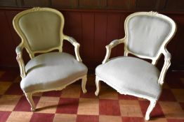 A pair of Louis XV style fauteuils with white painted frames in pale woven upholstery. H.95 W.