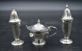 A cased silver cruet set, mustard pot and spoon and salt and pepper shakers. EV for Viners Ltd,
