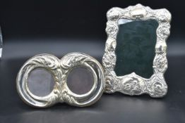 A embossed silver framed easel picture frame, Birmingham 1897 and a late 19th century silver twin