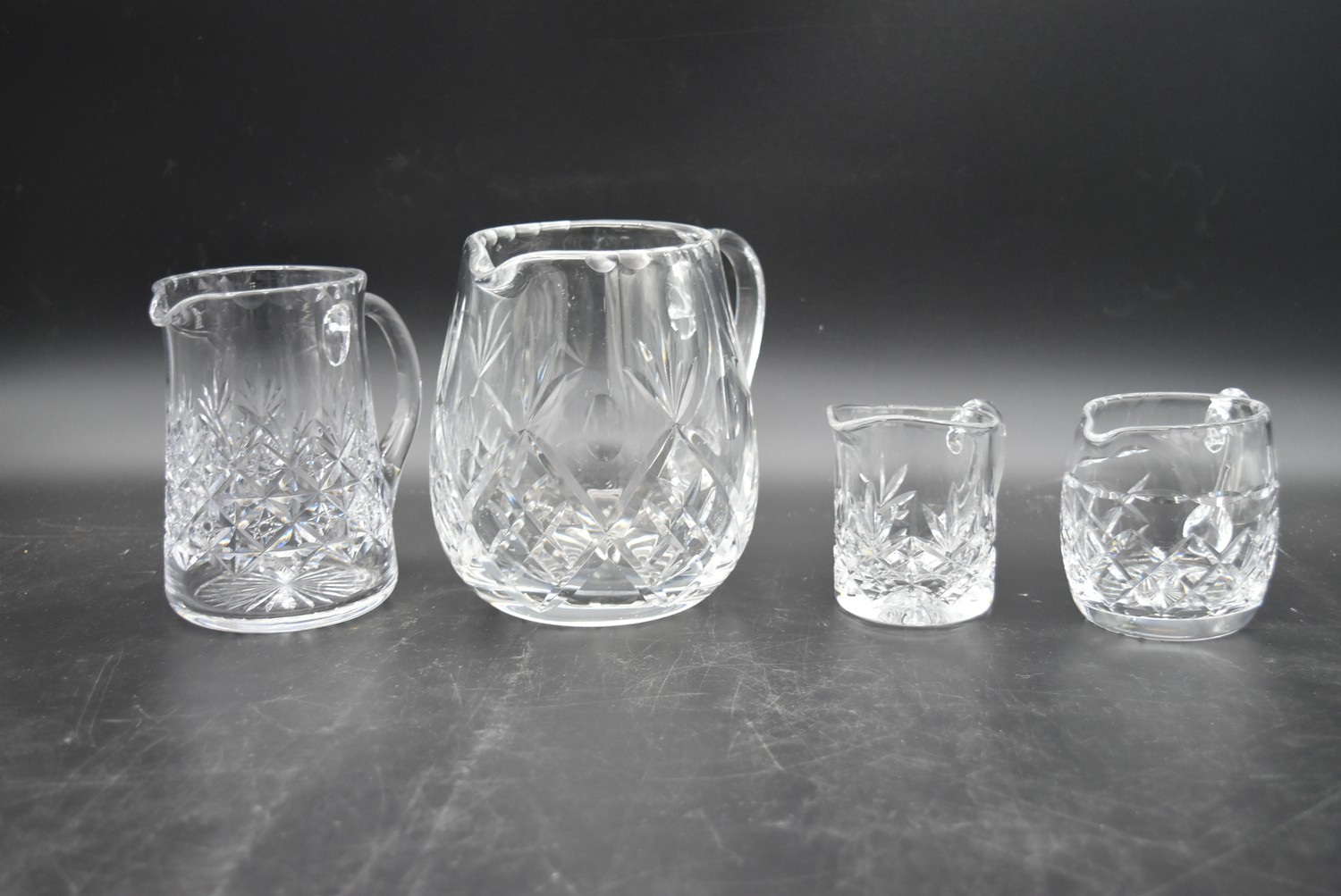 An extensive suite of cut crystal to include port and sherry glasses, champagne cups, vases, water - Image 13 of 15