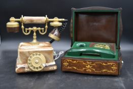 An alabaster and brass telephone in the antique style and a vintage green telephone cased in a