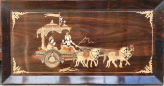 An inlaid Eastern rosewood panel depicting a couple in a ceremonial carriage in a rosewood frame.