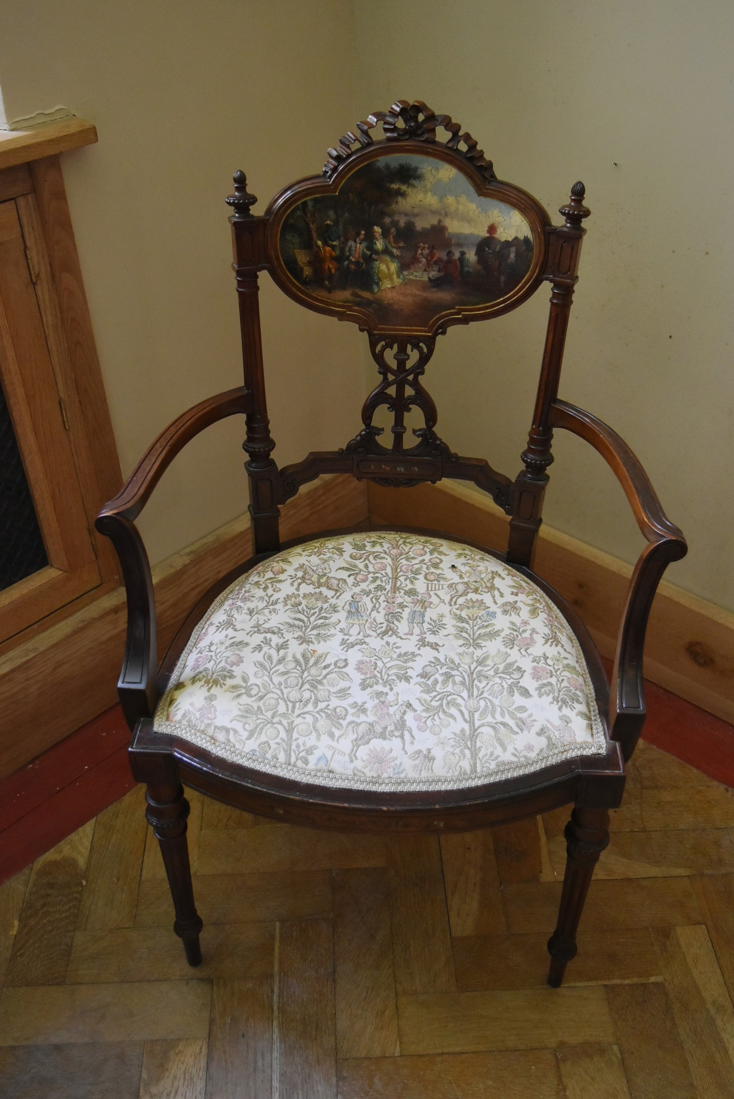 A late 19th century carved walnut salon armchair with hand painted back panel on fluted tapering - Image 2 of 5