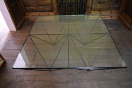 A large Italian metal framed coffee table on quartered inverted pyramid supports with plate glass