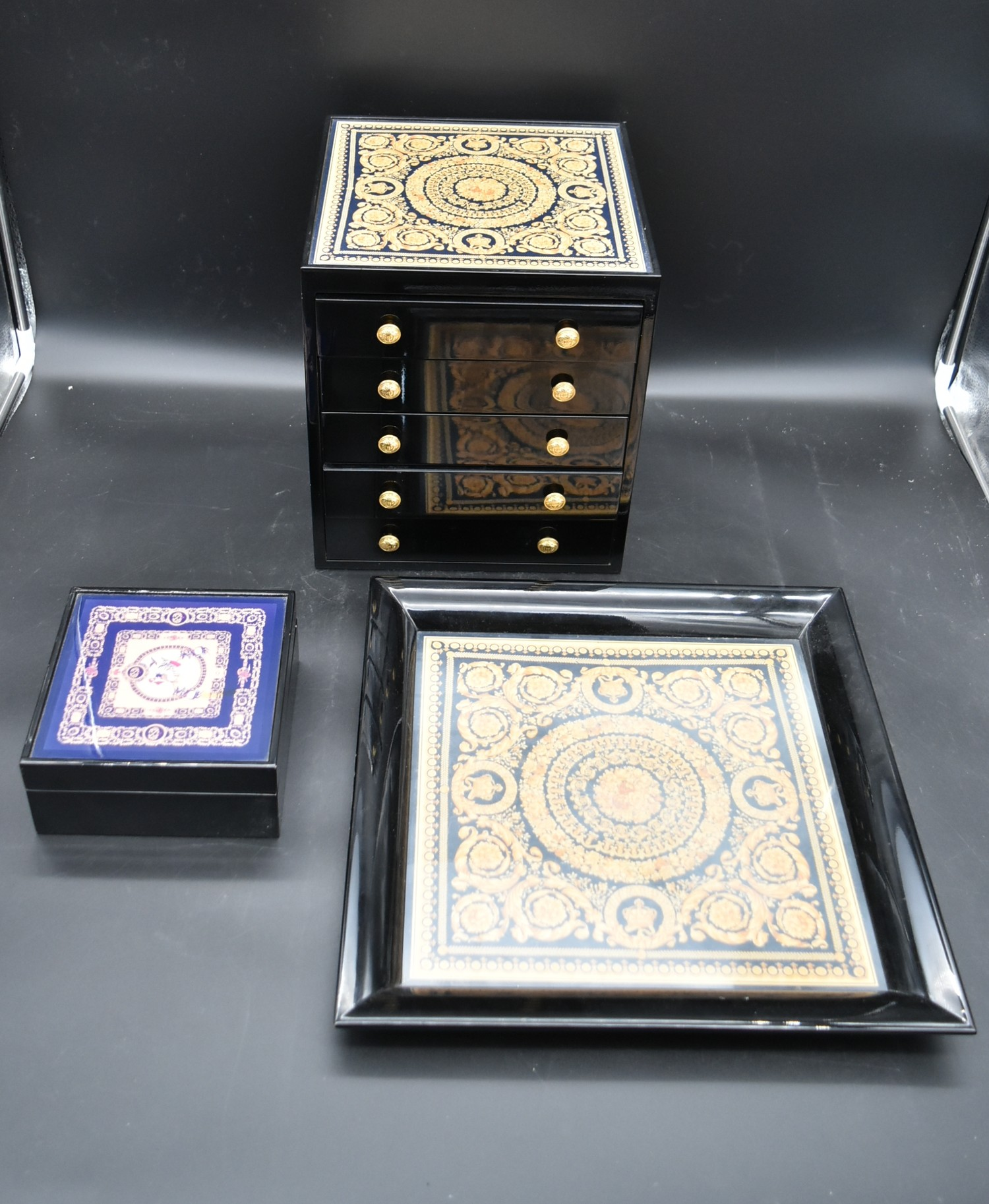 A lacquered Gianni Versace tray along with a similar jewellery chest and a lidded trinket box. H.