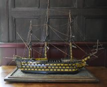 A scratch built model of the H.M.S. Victory fully rigged and detailed throughout on oak base. H.57