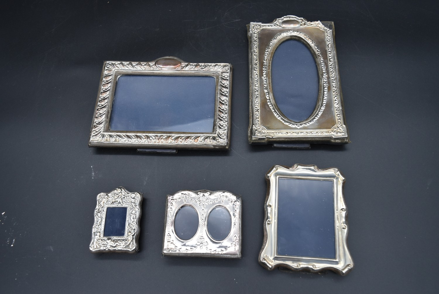A miscellaneous collection of silver framed easel mirrors, various English hallmarks. H.20cm W.