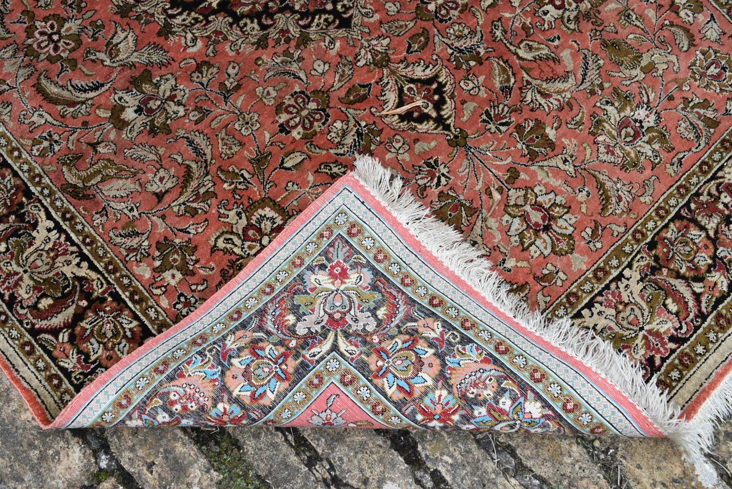 A pair of silk Persian rugs with central floral pole medallion on a madder ground with scrolling - Image 4 of 4