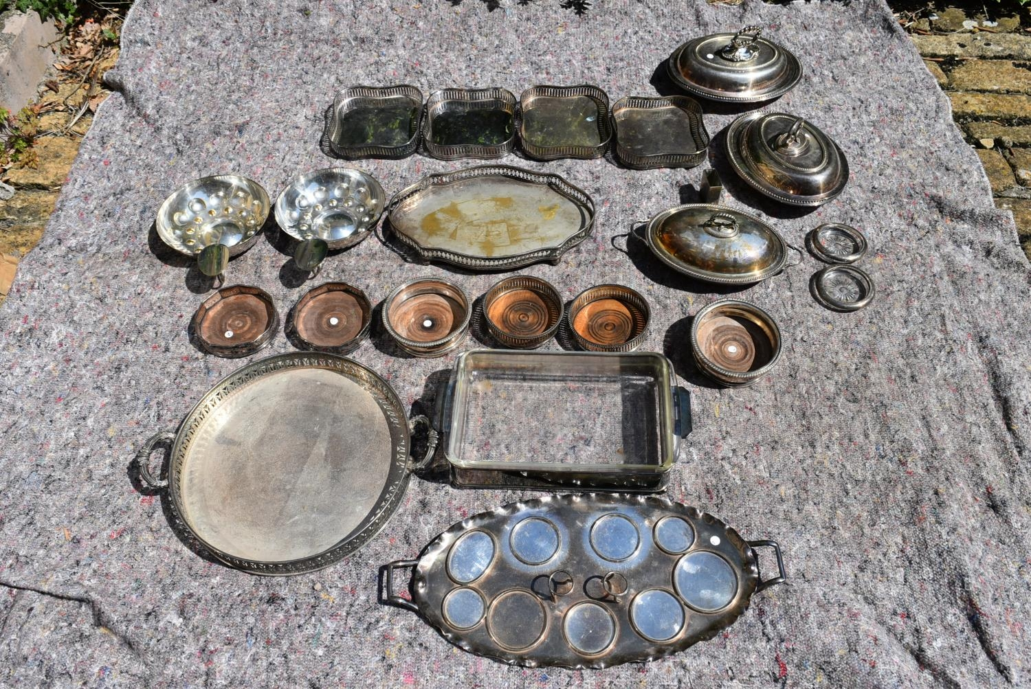 An extensive collection of silver plated items to include a set of four galleried trays, a pair of
