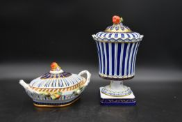 A Continental lidded urn and pierced lidded dish, both with fruit finials and hand gilded and