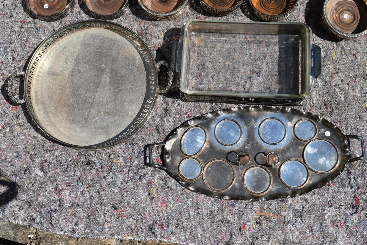 An extensive collection of silver plated items to include a set of four galleried trays, a pair of - Image 2 of 5