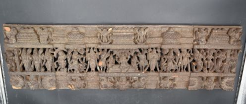 An antique Indian carved and pierced hardwood narrative panel with various Indian gods and animals