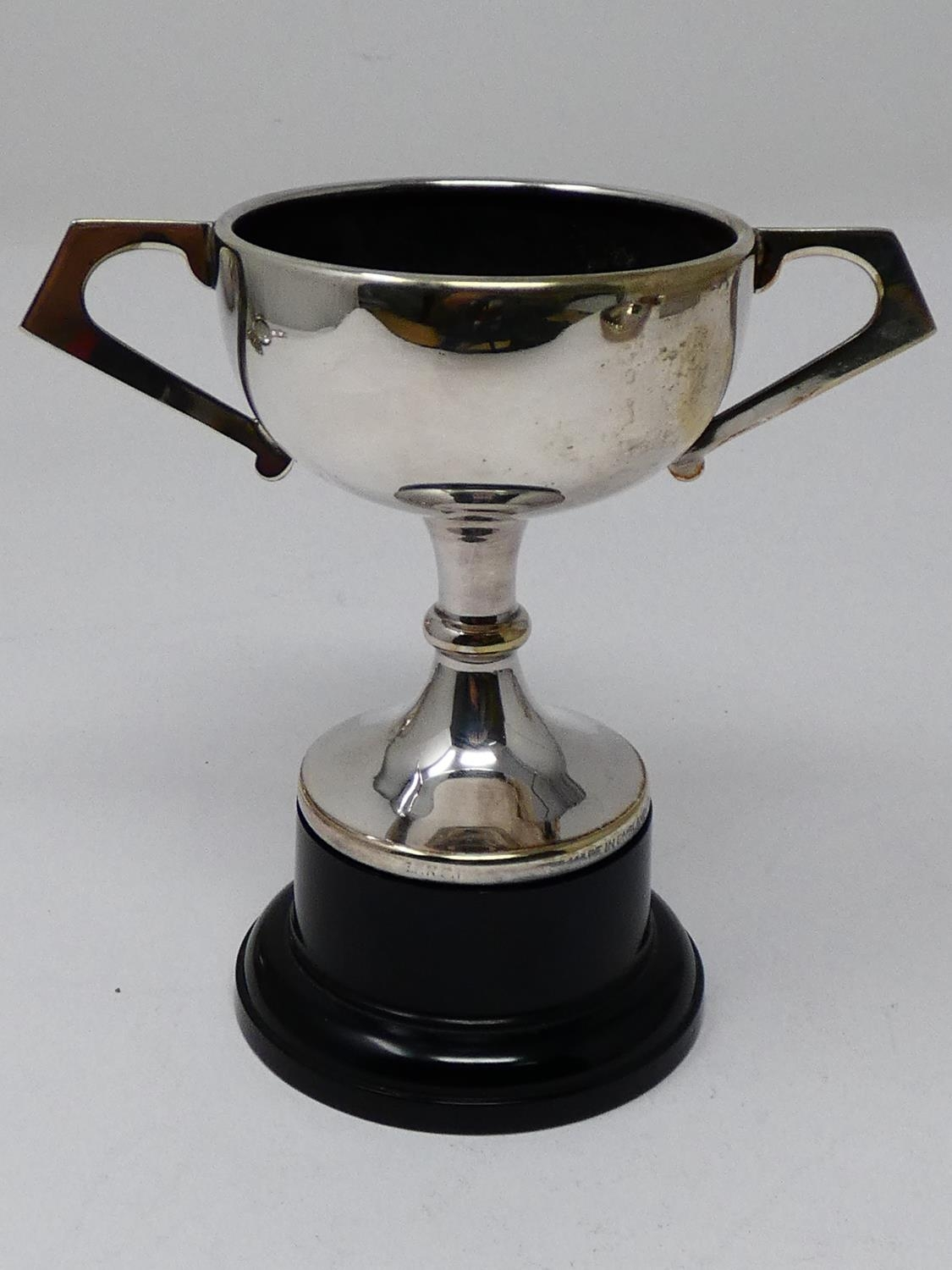 A collection of silver plated items; a hot water jug, trophy cups, card tray and hand mirrors (one - Image 19 of 23