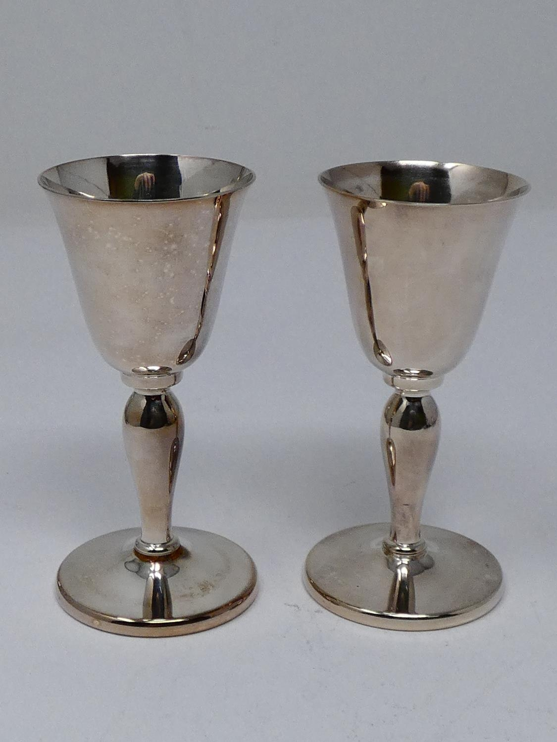 A collection of silver plated items; a hot water jug, trophy cups, card tray and hand mirrors (one - Image 15 of 23