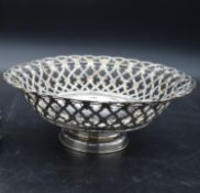 A pierced and engraved floral design Italian silver pedestal bowl with round foot. Maker UnoAErre,