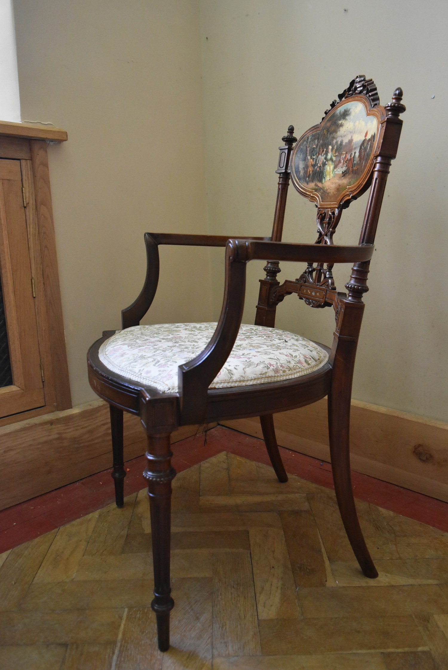 A late 19th century carved walnut salon armchair with hand painted back panel on fluted tapering - Image 3 of 5