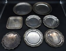 A set of four silver plated trays, two similar trays with gadrooned edges and two engraved trays.