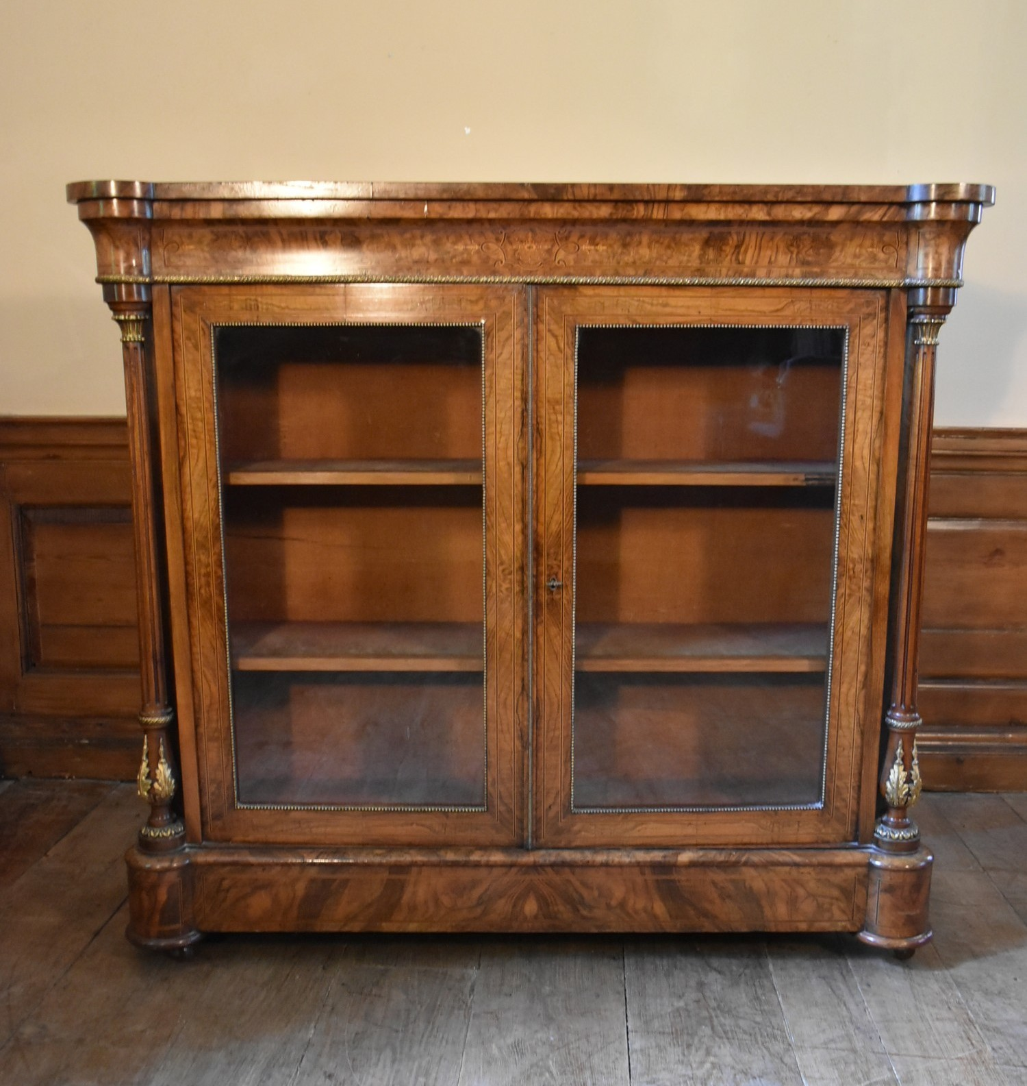 A Victorian burr walnut with satinwood and ebony strung pier cabinet with ormolu mounts and a pair