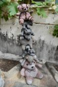 Ross Bonfanti, concrete and mixed material sculpture, a family of teddy bears perched one on top